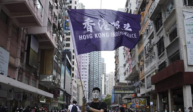 A protester waves a flag in support of Hong Kong independence at an anti-government protest on May 24. Photo: Winson Wong