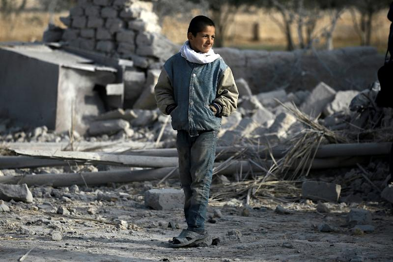 A Syrian boy stands near rubble in Bir Saeed on February 7, 2017 (AFP Photo/Delil Souleiman)