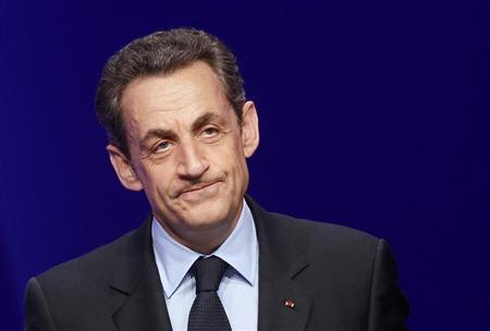 France's President and UMP party candidate for the 2012 French presidential elections Sarkozy addresses supporters at La Mutualite meeting hall in Paris