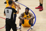 Utah Jazz forward Royce O'Neale, right, sits on the floor after committing a foul as referee Zach Zarba gestures during the second half in Game 4 of a second-round NBA basketball playoff series against the Los Angeles Clippers Monday, June 14, 2021, in Los Angeles. (AP Photo/Mark J. Terrill)