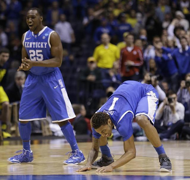 Kentucky's James Young (1) and Dominique Hawkins (25) react during the second half of an NCAA Midwest Regional final college basketball tournament game against Michigan Sunday, March 30, 2014, in Indianapolis. (AP Photo/David J. Phillip)