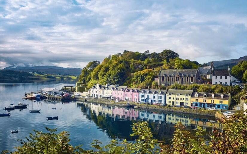 Some of the UK's most beautiful corners can be found on British Isles cruises in 2021, such as Portree on the Isle of Skye - EASYTURN