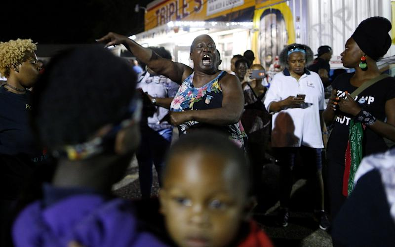 Alton Sterling's aunt Veda Washington-Abusaleh speaks to community members during a vigil at the Triple S Food Mart on Tuesday night - Credit: Reuters