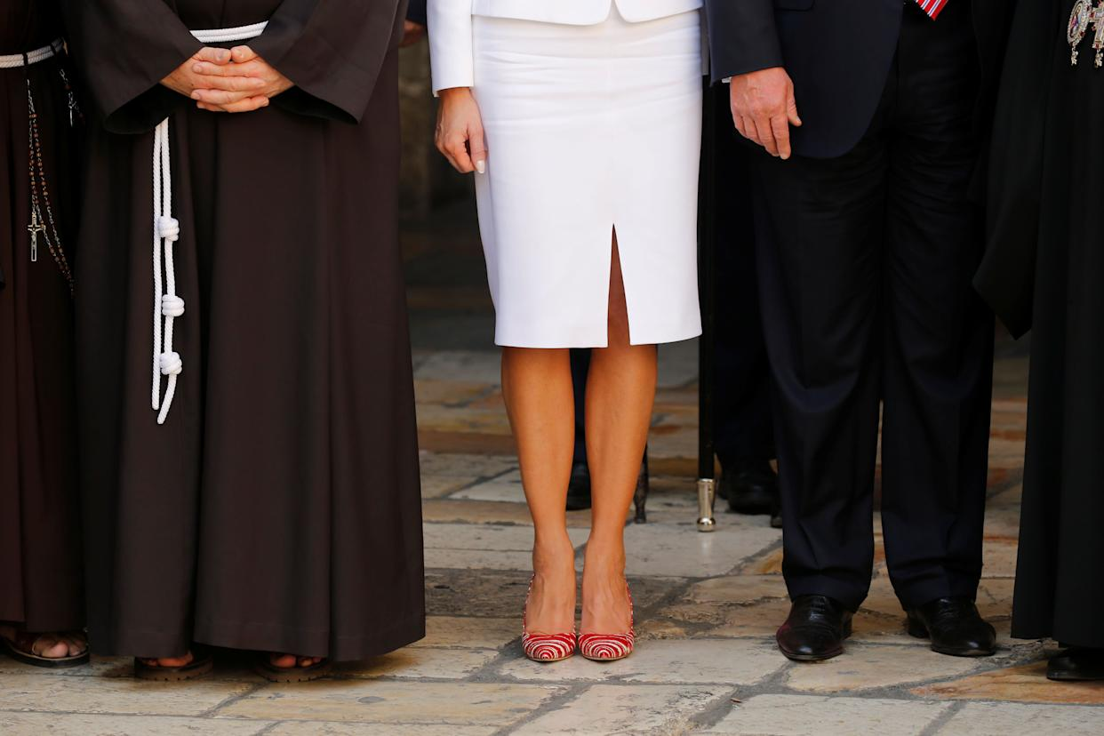 Melania and Donald Trump stand next to members of the Christian clergy during their visit to the Church of the Holy Sepulchre in Jerusalem's Old City on May 22, 2017.