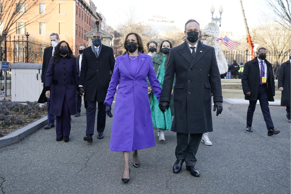 Vice President Kamala Harris, and her husband Doug Emhoff, walk during the Inauguration Day Parade Route in Washington, Wednesday, Jan. 20, 2021, after being sworn in as the 46th vice president of the United States. (AP Photo/Jacquelyn Martin)