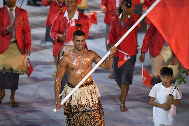 Tonga's flagbearer Pita Nikolas Taufatofua leads his delegation during the opening ceremony of the Rio 2016 Olympic Games. (Getty)