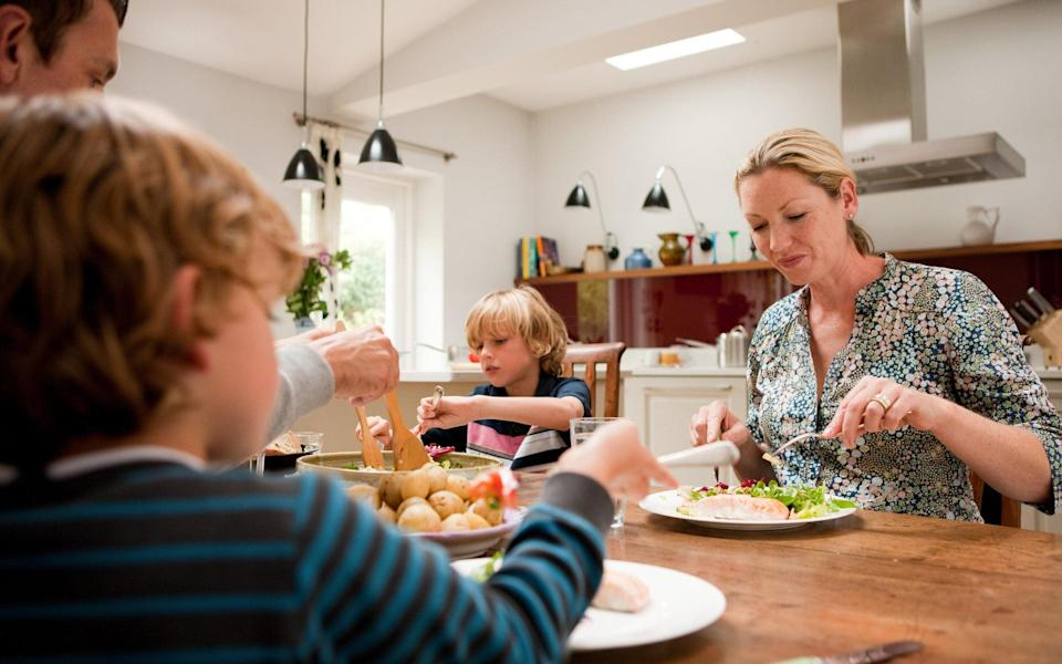 family dinner table - Getty Images
