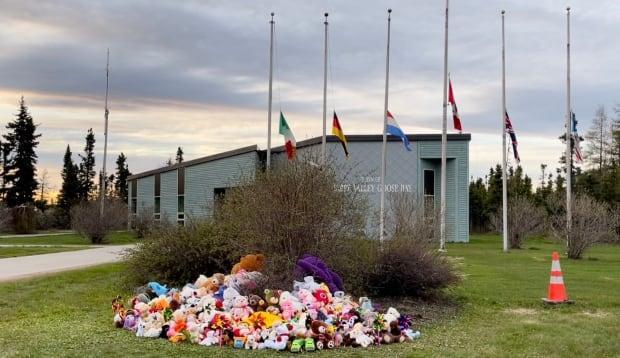Teddy bears and toys continued to be added to the memorial long after Monday afternoon's ceremony finished. The town is also flying its flags at half-mast in memory of the children.