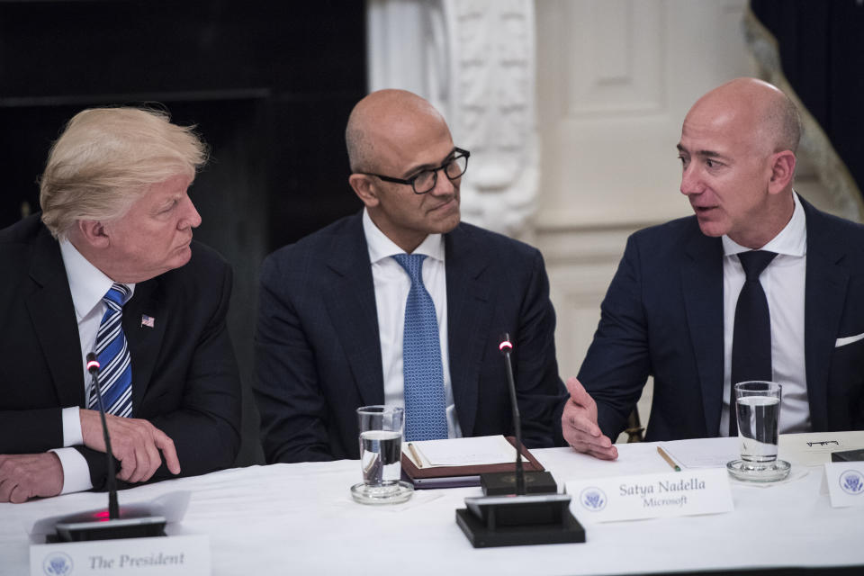 WASHINGTON, DC - JUNE 19: President Donald Trump speaks with Satya Nadella, Chief Executive Officer of Microsoft, and Jeff Bezos, Chief Executive Officer of Amazon during an American Technology Council roundtable in the State Dinning Room at the White House in Washington, DC on Monday, June 19, 2017. (Photo by Jabin Botsford/The Washington Post via Getty Images)