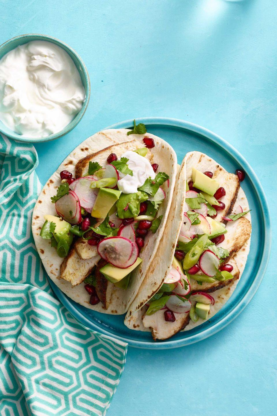 """<p>Avocado is packed with monounsaturated fats that help reduce inflammation and will help you feel fuller longer.</p><p><strong><a href=""""https://www.countryliving.com/food-drinks/recipes/a33282/spiced-chicken-tacos-avocado-pomegranate-salsa-recipe-wdy0315/"""" rel=""""nofollow noopener"""" target=""""_blank"""" data-ylk=""""slk:Get the recipe"""" class=""""link rapid-noclick-resp"""">Get the recipe</a>.</strong></p>"""