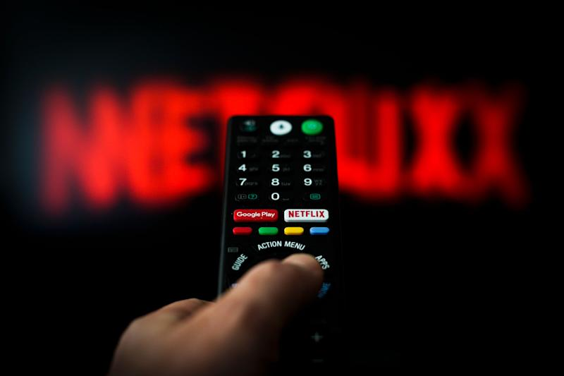 A button for launching the Netflix application is seen on a remote control in this photo illustration in Warsaw, Poland on April 25, 2019. According to an article published in the Wall Street Journal Netflix has been causing a decrease in sexual activity especially amongst millennials. (Photo by Jaap Arriens/NurPhoto via Getty Images)
