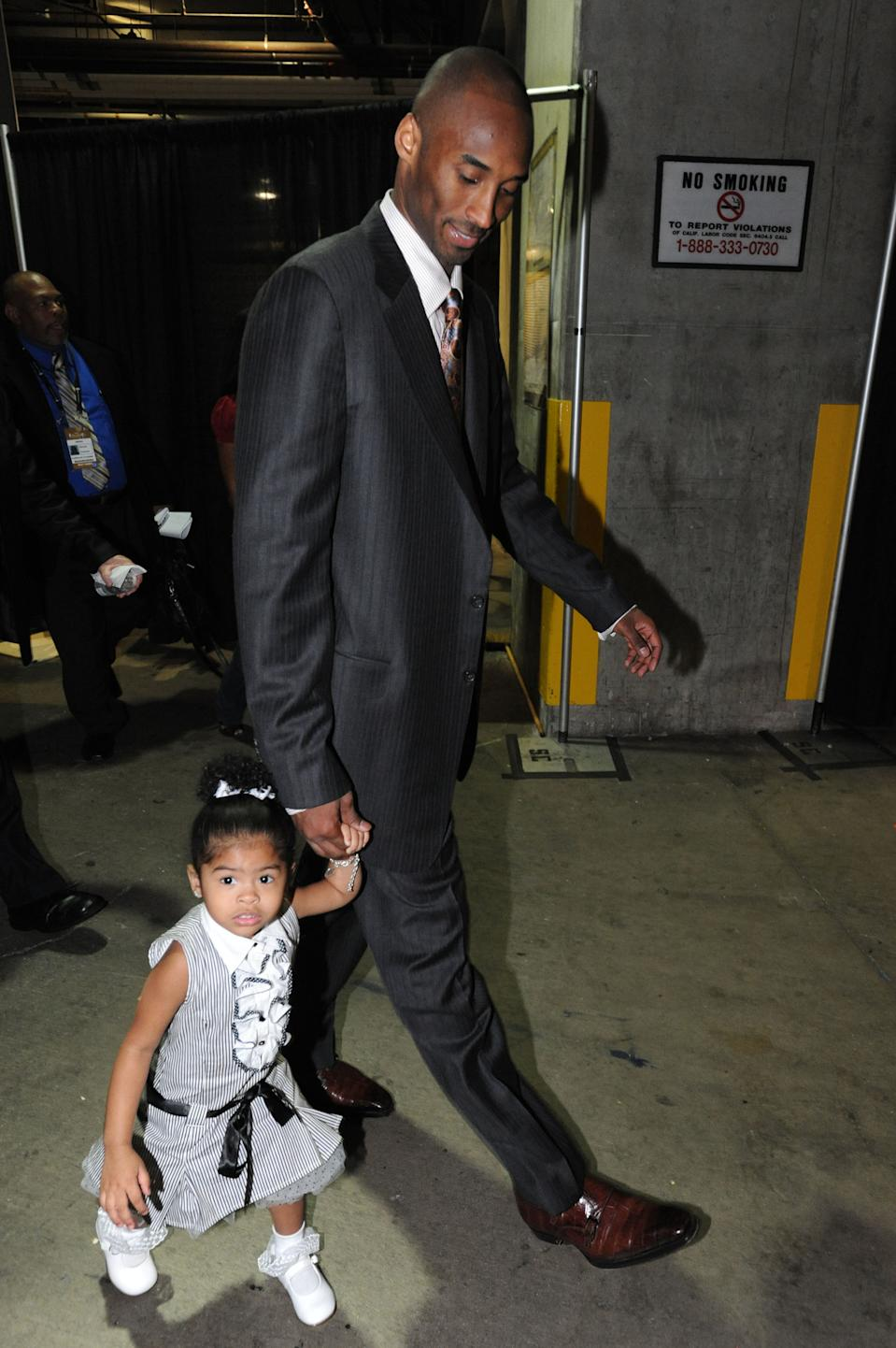 Kobe Bryant #24 of the Los Angeles Lakers walks out of the arena with daughter Gianna following his team's victory over the Boston Celtics in Game Five of the 2008 NBA Finals at Staples Center June 15, 2008 in Los Angeles, California. (Photo by Andrew D. Bernstein/NBAE via Getty Images)