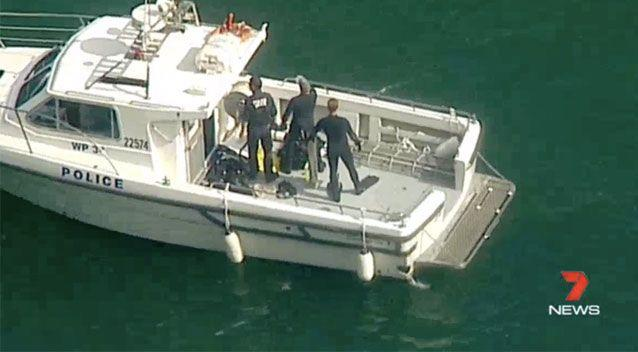 Search teams prepare themselves for entering the water. Source: 7News