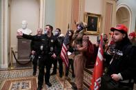 FILE PHOTO: Trump supporters breach the US Capitol