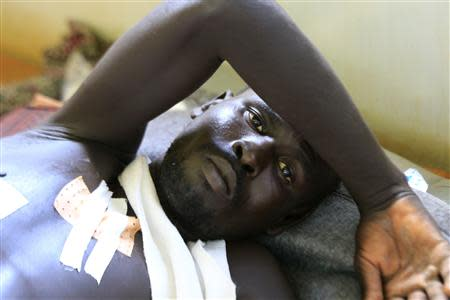 A displaced man, undergoing treatments for his injuries, is seen at a United Nations hospital at Tomping camp, where some 15,000 displaced people who fled their homes are sheltered by the UN near South Sudan's capital Juba January 7, 2014. REUTERS/James Akena