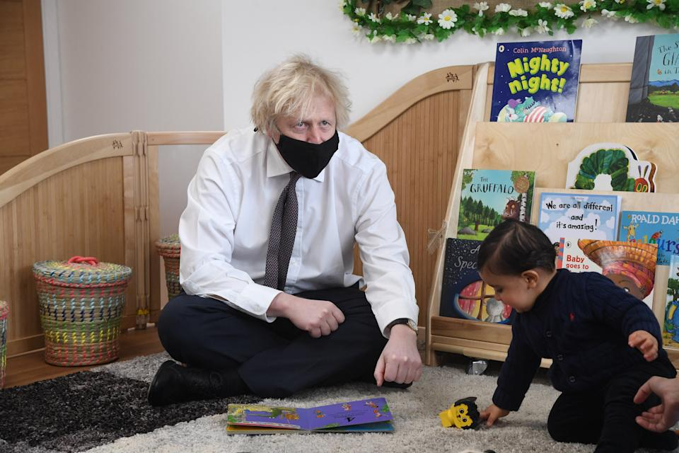 Britain's Prime Minister Boris Johnson visits the Monkey Puzzle Nursery in west London on March 25, 2021. (Photo by JEREMY SELWYN / POOL / AFP) (Photo by JEREMY SELWYN/POOL/AFP via Getty Images)