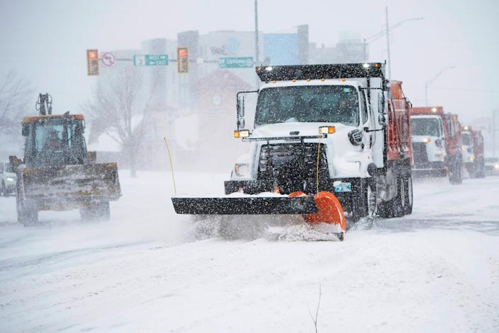 A snowplow works to clear an intersection in Oklahoma City Sunday.  Snow and ice blanketed large swaths of the U.S., prompting canceled flights, making driving perilous and reaching into areas as far south as Texas' Gulf Coast.