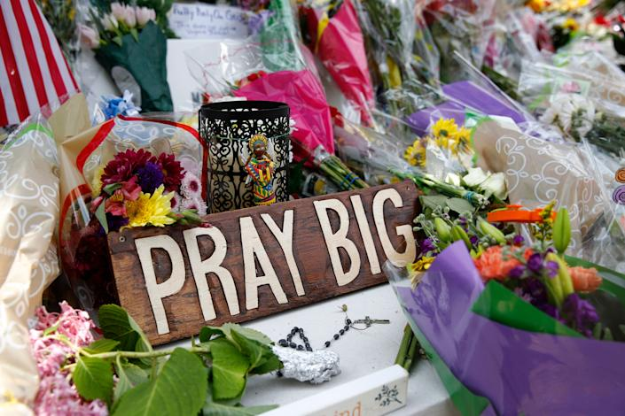 A sign sits among flowers and mementos left at a makeshift memorial for victims of a mass shooting at a municipal building in Virginia Beach, Va. (Photo: Patrick Semansky/AP)