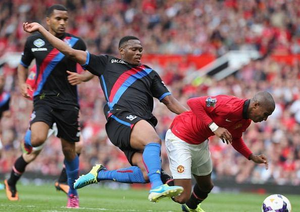 Ashley Young of Manchester United clashes with Kagisho Dikgacoi of Crystal Palace