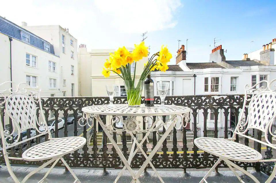 """<p>An Edwardian balcony apartment sitting just moments from the beach, this Airbnb in Brighton has an alfresco space to soak up the rays while you enjoying your morning coffee. There's an open-plan kitchen with exposed brickwork, wooden floors and a large bathroom with a roll top bath and underfloor heating. </p><p><strong>Sleeps:</strong> Two</p><p><strong>Price per night: </strong>£70.00</p><p><strong>Why we like it:</strong> A central location and sun-kissed balcony gets our vote every time</p><p><a class=""""link rapid-noclick-resp"""" href=""""https://airbnb.pvxt.net/x99YGk"""" rel=""""nofollow noopener"""" target=""""_blank"""" data-ylk=""""slk:SEE INSIDE"""">SEE INSIDE</a> </p>"""