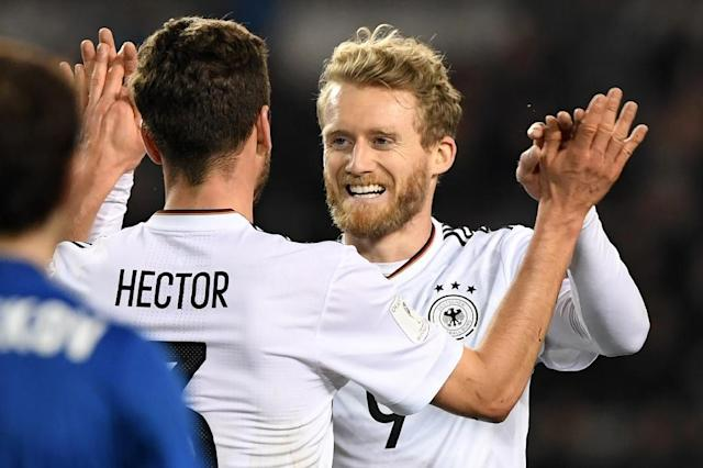 Germany's Andre Schuerrle (R) celebrates with Jonas Hector after scoring a goal against Azerbaijan on March 26, 2017 (AFP Photo/Kirill KUDRYAVTSEV)
