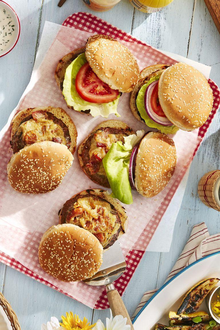 """<p>You'll never need another burger recipe after grilling up these patties. They're so good, all your guests will be asking for another. </p><p><strong><a href=""""https://www.countryliving.com/food-drinks/a28188362/worcestershire-glazed-burgers-recipe/"""" rel=""""nofollow noopener"""" target=""""_blank"""" data-ylk=""""slk:Get the recipe"""" class=""""link rapid-noclick-resp"""">Get the recipe</a></strong><strong>.</strong> </p>"""