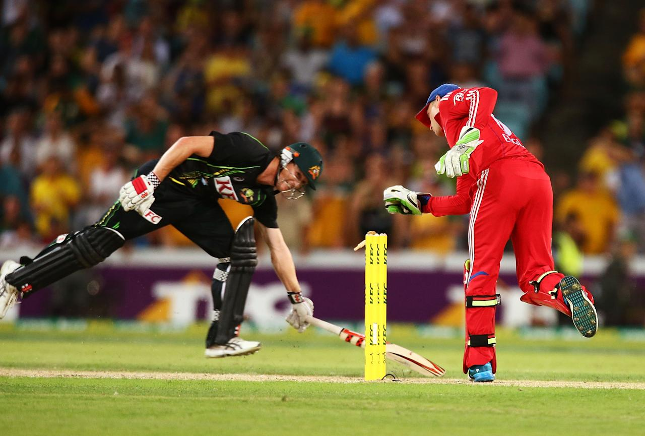 SYDNEY, AUSTRALIA - FEBRUARY 02: George Bailey of Australia survives a run out attempt on the last ball of the innings  during game three of the International Twenty20 series between Australia and England at ANZ Stadium on February 2, 2014 in Sydney, Australia.  (Photo by Mark Nolan/Getty Images)