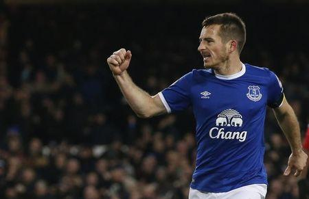 Everton's Leighton Baines celebrates scoring their first goal