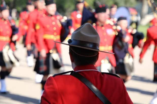 An officer takes position during the change of command ceremony on September 6, 2018 for new commissioner Brenda Lucki at the RCMP Heritage Centre in Regina.