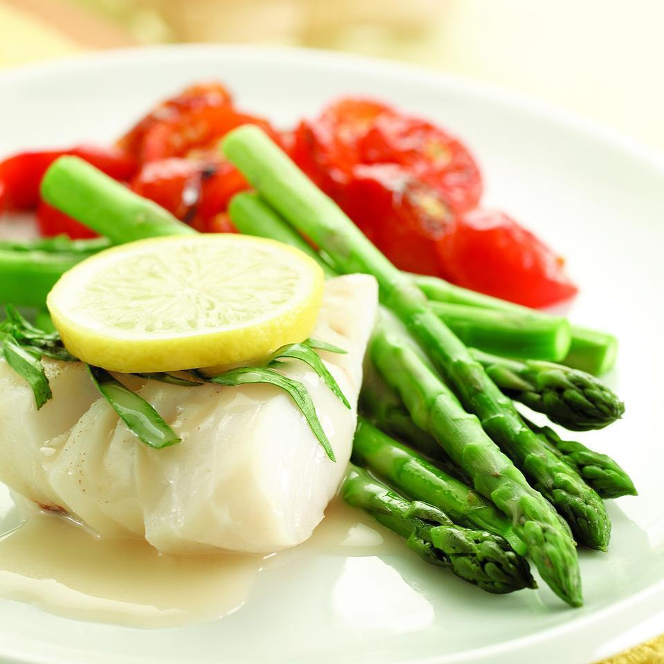 <p>In this recipe, we poach the cod right on top of the asparagus. The result is perfectly cooked cod and tender-crisp asparagus. The sauce is our take on beurre blanc--a traditional French sauce made with wine and lots of butter. Ours uses a little cornstarch for thickening and a judicious amount of butter for flavor.</p>