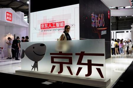 FILE PHOTO: A sign of China's e-commerce company JD.com is seen at CES (Consumer Electronics Show) Asia 2018 in Shanghai