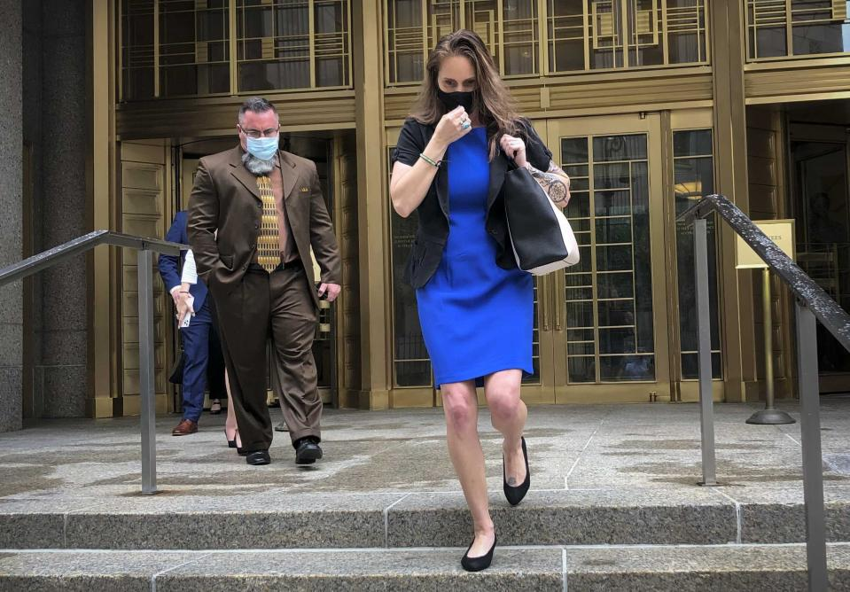 Natalie Mayflower Sours Edwards, right, leaves court after receiving a six-month prison sentence for leaking confidential financial reports to a journalist at Buzzfeed, Thursday June 3, 2021, in New York. (AP Photo/Larry Neumeister)