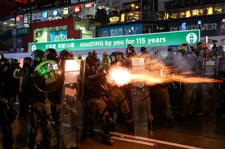 Police fire tear gas at pro-democracy demonstrators in Hong Kong's Causeway Bay district on August 31, 2019