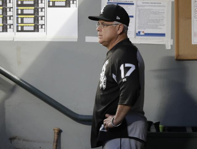Chicago White Sox manager Rick Renteria stands in the dugout during a baseball game against the Seattle Mariners, Friday, July 20, 2018, in Seattle. (AP Photo/Ted S. Warren)