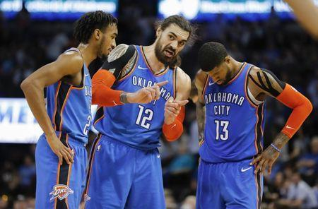 Mar 13, 2019; Oklahoma City, OK, USA; Oklahoma City Thunder center Steven Adams (12) speaks with Oklaho Thunder guard Terrance Ferguson (23) and Thunder forward Paul George (13) during a stoppage in play in the second half at Chesapeake Energy Arena. Mandatory Credit: Alonzo Adams-USA TODAY Sports