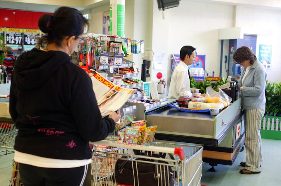 Woman standing in Woolworths checkout line. Source: Getty Images