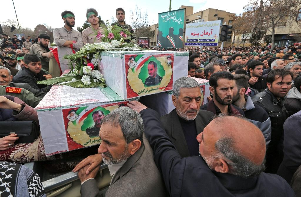 """Tens of thousands chanted """"down with America"""" and """"we will never submit"""" at the funeral of Revolutionary Guards killed in Wednesday's attack by a jihadist group Tehran accuses Pakistan of supporting (AFP Photo/ATTA KENARE)"""