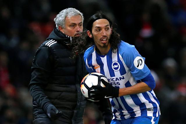 Soccer Football - FA Cup Quarter Final - Manchester United vs Brighton & Hove Albion - Old Trafford, Manchester, Britain - March 17, 2018 Brighton's Ezequiel Schelotto collects the ball from Manchester United manager Jose Mourinho REUTERS/Andrew Yates