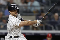 New York Yankees designated hitter Giancarlo Stanton hits an RBI single against the Philadelphia Phillies during the seventh inning of a baseball game Wednesday, July 21, 2021, in New York. (AP Photo/Adam Hunger)