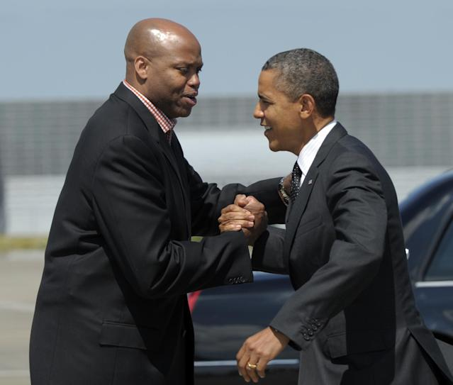 FILE - In this July 24, 2012 file photo, President Barack Obama greets his brother-in-law, Oregon State basketball coach Craig Robinson, after arriving at Portland International Airport in Portland, Ore. Oregon State fired Robinson, Monday, May 5, 2014, after six seasons without making the NCAA tournament. (AP Photo/Susan Walsh, File)