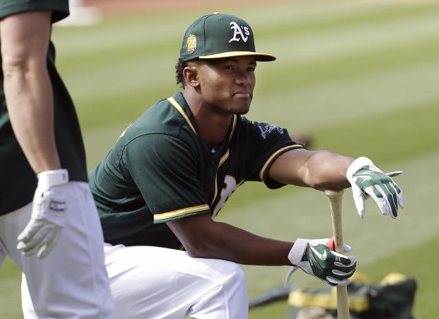 FILE - In this Friday, June 15, 2018 file photo, Oakland Athletics draft pick Kyler Murray waits to hit during batting practice before a baseball game between the Athletics and the Los Angeles Angels in Oakland, Calif. Kyler Murray suddenly has a bunch of new fans in the Oakland Athletics organization, even if they cringe watching Heisman Trophy winner play quarterback for Oklahoma. The A's don't want their prized first-round draft pick hurt on the football field because they are counting on him wearing an Oakland jersey come spring training. (AP Photo/Jeff Chiu, File)