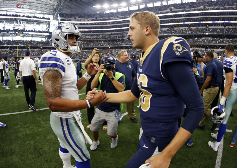 Cowboys quarterback Dak Prescott, left, and Rams quarterback Jared Goff have each benefitted from their situation. (AP Photo/Ron Jenkins)