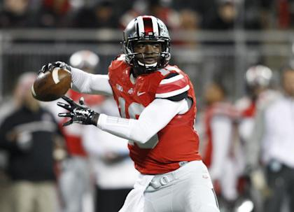 J.T. Barrett has filled in admirably this season after the Buckeyes lost starting QB Braxton Miller. (AP)