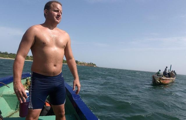 British swimmer Ben Hooper stands on a boat during a training session in Dakar on October 28, 2016 (AFP Photo/SEYLLOU)