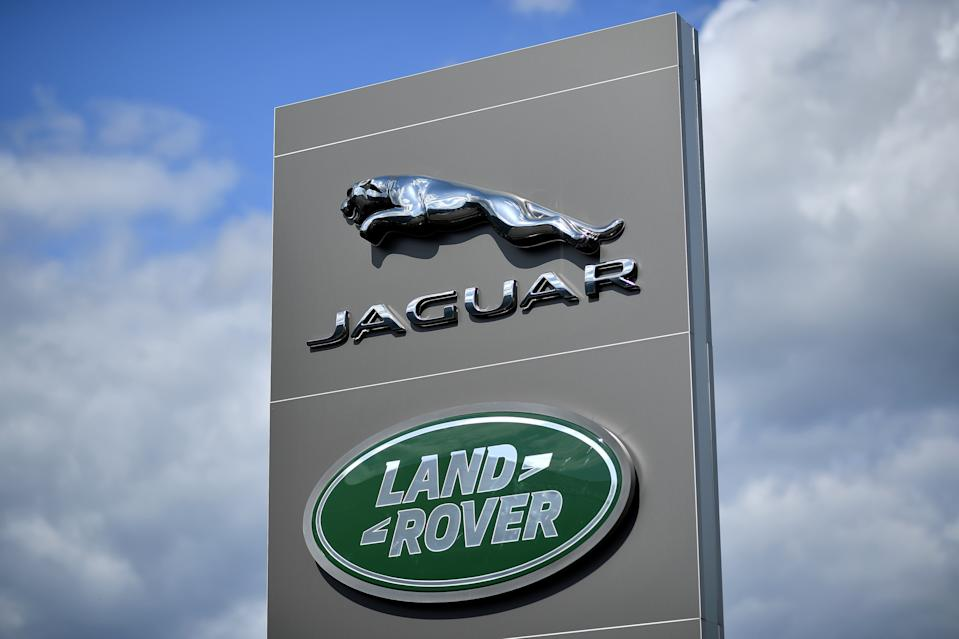 A logo is pictured outside a Jaguar Land Rover new car show room in Tonbridge, south east England, on May 24, 2020. - Jaguar Land Rover (JLR), owned by India's Tata Motors, was on Sunday said to be in talks with Britain's government in the hope of to securing a loan following a drop in sales due to the COVID-19 coronavirus pandemic. (Photo by Ben STANSALL / AFP) (Photo by BEN STANSALL/AFP via Getty Images)