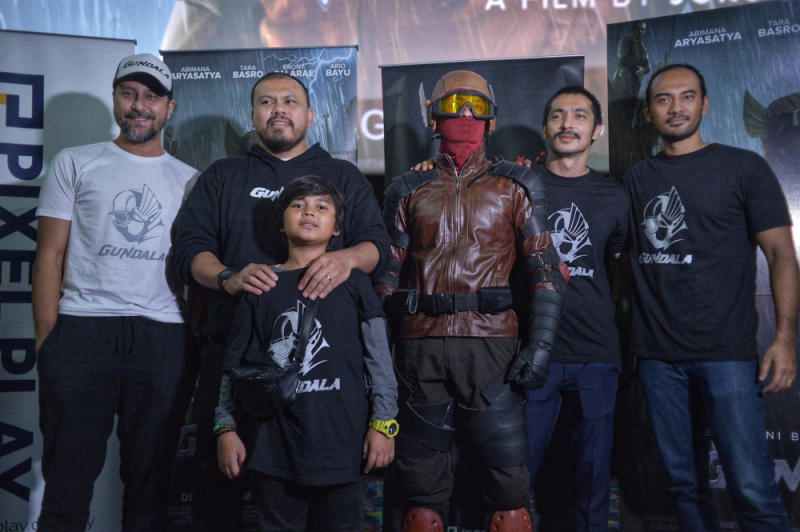 Joko Anwar (2nd left) poses with the cast of 'Gundala' during a press screening at TGV Cinemas in Suria KLCC. — Picture by Shafwan Zaidon