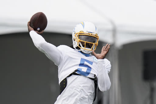 Chargers' new era opens with Taylor taking the reins at QB