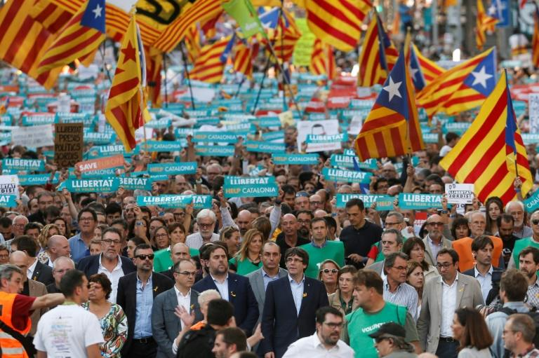​Catalan leaders including regional president Carles Puigdemont join a rally in Barcelona in support of separatists