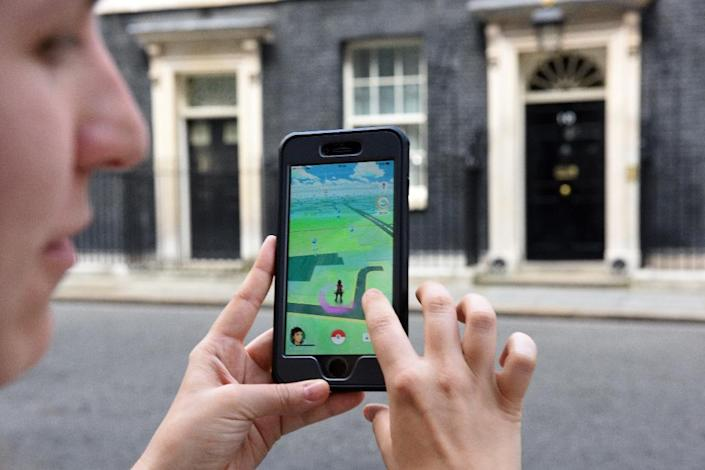 A strong selling point for Pokemon Go sponsorships is that they get people swarming to places in a way that typical advertising does not (AFP Photo/Oli Scarff)