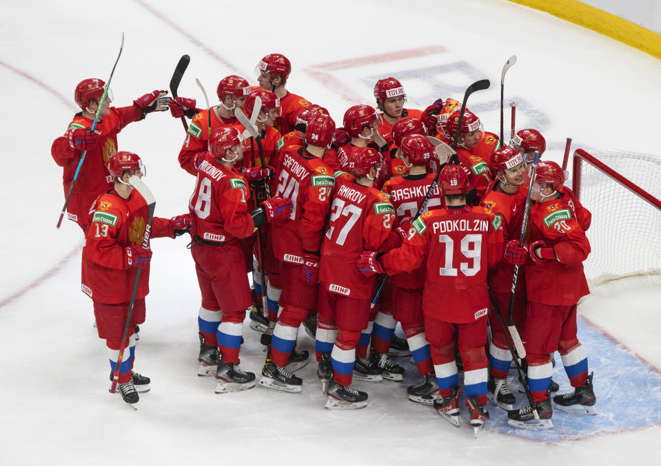 Russia players celebrates the win over Germany during an IIHF World Junior Hockey Championship game in Edmonton, Alberta, on Saturday, Jan. 2, 2021. (Jason Franson/The Canadian Press via AP)